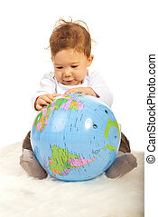 Baby boy with world globe - Baby boy sitting on fur blanket...
