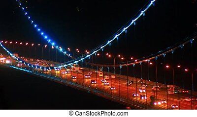 Heavy traffic on suspended bridge - Night traffic on Trans...