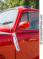 Details of a red and shiny vintage beetle car