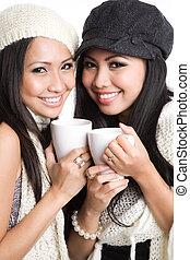 Asian women drinking coffee - Two beautiful smiling asian...