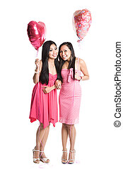 Asian women celebrating valentine day - Two beautiful asian...