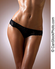 Slim tanned woman's body. - Beautiful tanned woman's body in...