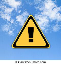 Warning sign on beautiful sky background.