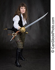 The girl - pirate with a sabre in hands on a black...