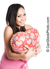 Asian woman hugging heart-shaped balloon - A beautiful asian...