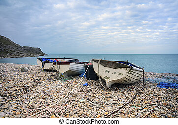 Boats at Chesil Cove - Fishing boats on the beach at Chesil...