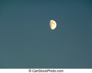 Half moon - Bright half moon in a deep blue sky