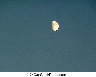 Half moon - Bright half moon in a deep blue sky
