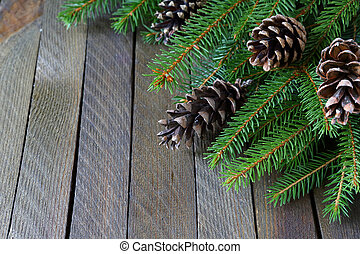 branches of spruce and pine cones on the boards, xmas