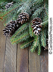 spruce twigs and cones covered with artificial snow