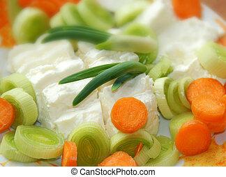 Leek cheese background - cut green leek and white cheese...