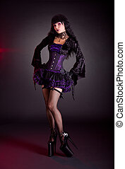 Sexy young woman in Victorian purple and black Halloween...