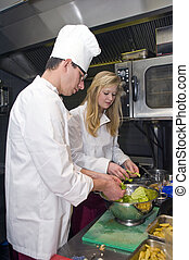 Preparing Salad - A chef and his sous chef picking salad...