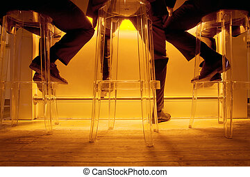 Socializing in a bar after work - Conceptual image of three...