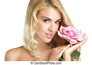 Beauty blonde young woman showing a fresh flower on white