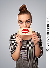 Happy pretty woman holding card with kiss lipstick mark on...