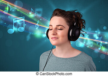 Young woman listening to music with headphones - Pretty...