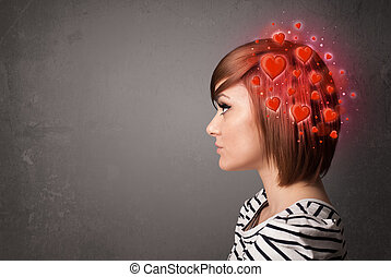 Young person thinking about love with red hearts - Young...