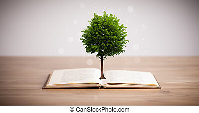 Tree growing from an open book, alternative recycling...
