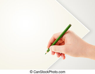 Human hand drawing with pencil on empty paper template -...