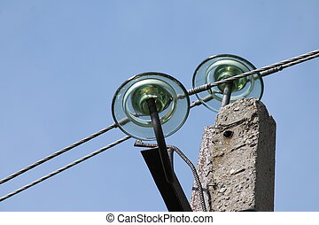 High voltage insulators on the support of a transmission...
