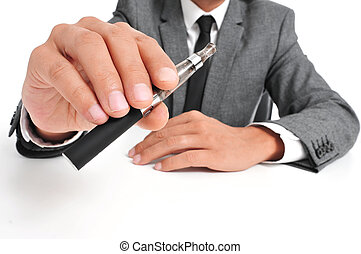 vaping with an electronic cigarette - man wearing a suit...