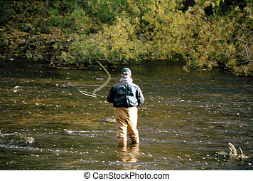 Fly fishing FF-1002 - Man fly fishing in a slow moving...