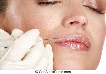 young beautiful model injecting a cosmetic treatment on...