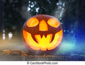 Scary halloween pumpkin - Concept of halloween with burning...