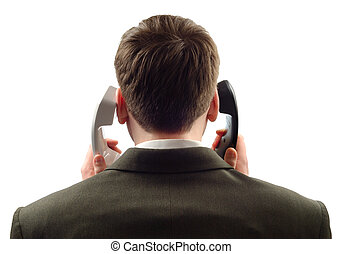 On The Phones - Businessman with two phone tubes isolated...