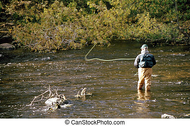 Fly Fishing FF-1012 - Man fly fishing in a slow moving...