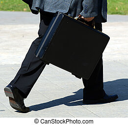 """Businessman walking with bag - """"Business on the run"""" concept"""