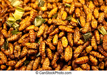 Thai Fried insects mealworms for snack.