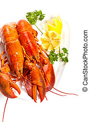 Boiled Lobster on dish - Lobster on dish with lemon slices