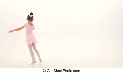 Ballet girl - Little ballet girl performing in a studio