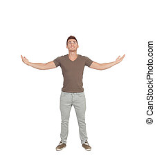 Casual young man looking up with arms extended isolated on a...