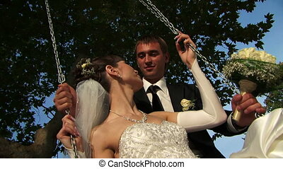 Couple in love - Wedding couple in love. Kissing in a park.