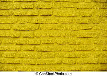 Yellow brick background - Yellow brick wall with stucco...