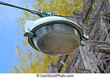 Street light hanging from cable