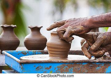 Pot Making - A man making a Pot Making