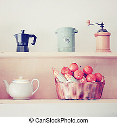 Tea and coffee equipment in kitchen with retro filter effect