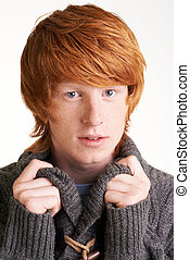 Young guy - Portrait of attractive redhead guy looking at...