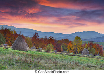 Colorful autumn sunset in the mountain village