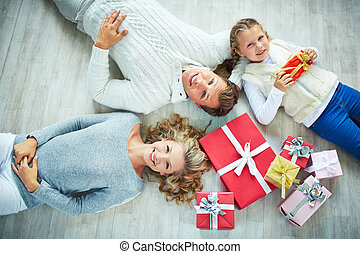 Family with gift boxes - Happy family with gift boxes lying...