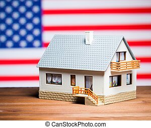 usa real estate concept: house against american flag