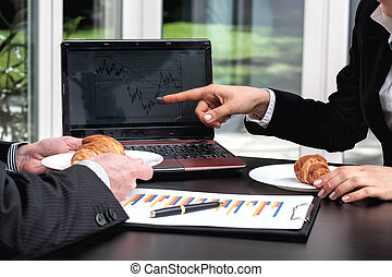 Business meeting with coffee and croissant - Business people...