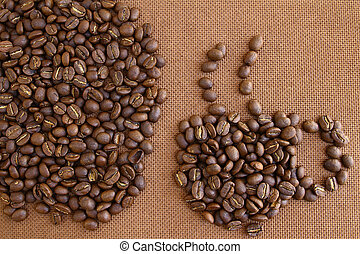Coffee beans on grung wooden board background - Coffee cup...