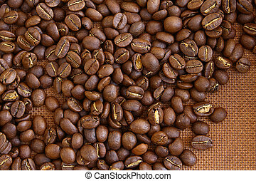 Coffee beans on grung wooden board background