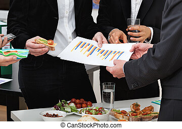Managers at business lunch - Managers analyzing chart at a...