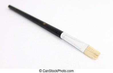 Wooden paint brush over white background